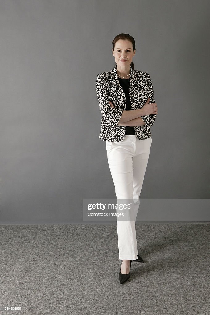 Businesswoman with arms folded : Stockfoto