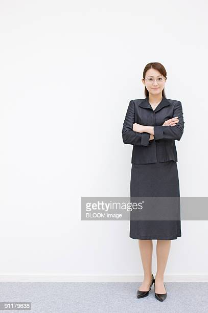 Businesswoman with arms folded, studio shot