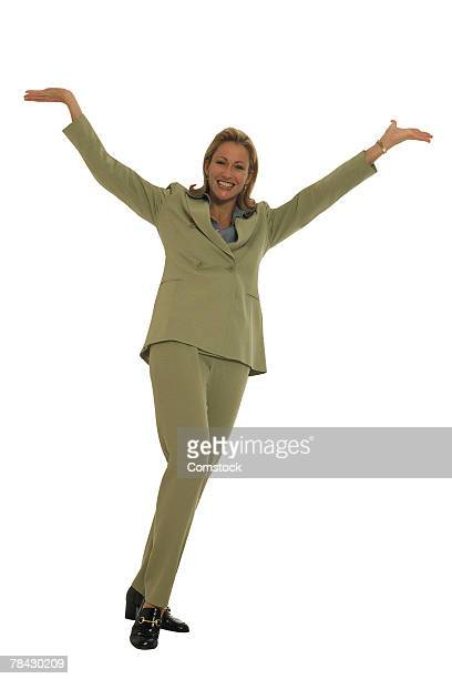 Businesswoman with arms open in greeting