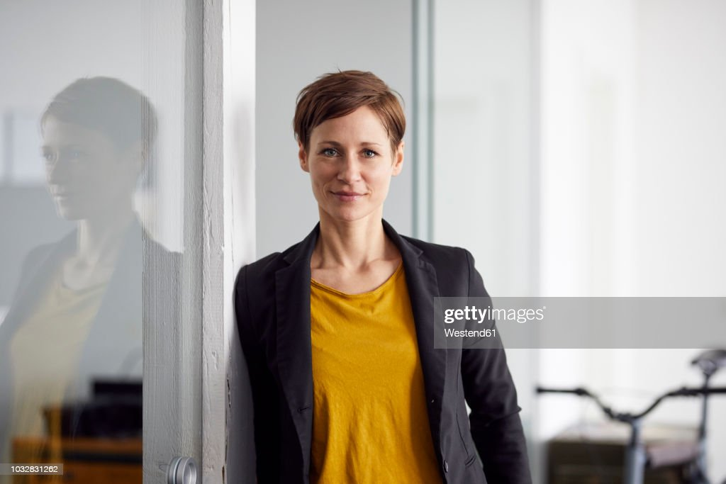 Businesswoman with bicycle in her start-up company : Stock-Foto