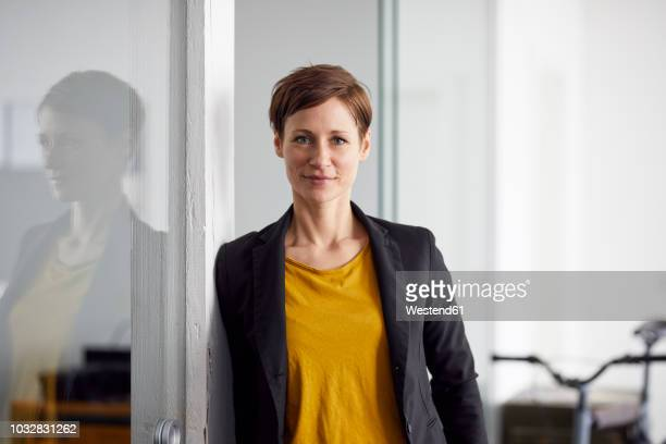 businesswoman with bicycle in her start-up company - looking at camera stock pictures, royalty-free photos & images