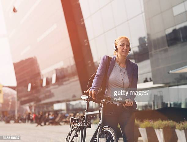 Businesswoman with Bicycle.