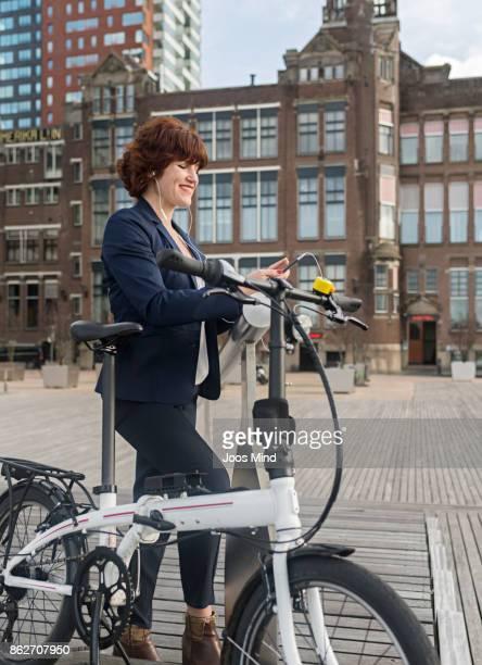 businesswoman with bike  using smart phone