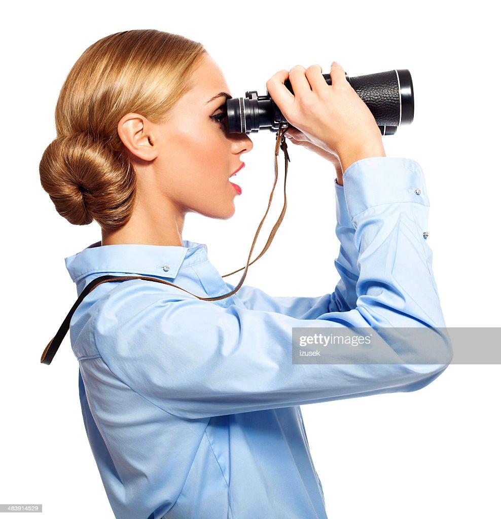 Empresária com binóculos : Foto de stock