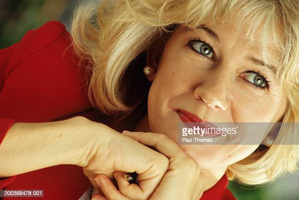 Businesswoman with blonde hair, close-up, portrait