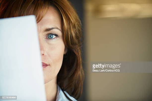 Businesswoman with blue eyes looking at document