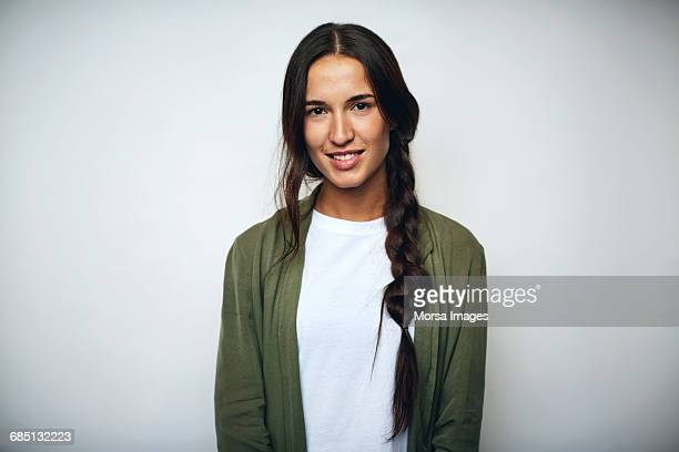 businesswoman with braided hair over white - grün stock-fotos und bilder
