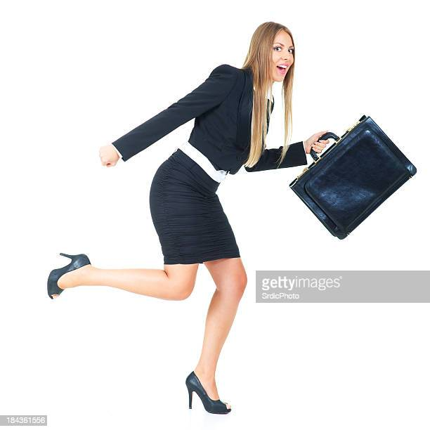 Businesswoman with briefcas running isolated on white background