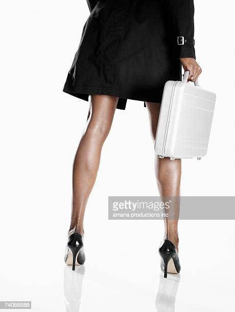 businesswoman with briefcase (low section, rear view) - stiletto stock pictures, royalty-free photos & images