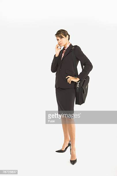 Businesswoman with Cell Phone and Shoulder Bag