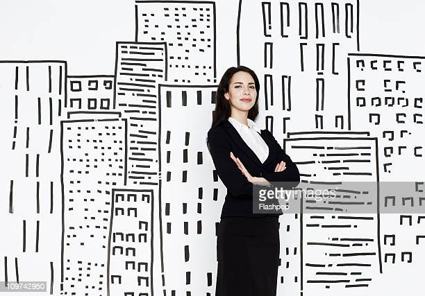 Businesswoman with city scape drawing
