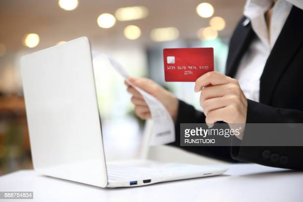 Businesswoman with credit card online shopping with laptop