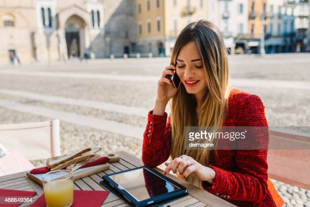 Businesswoman with digital tablet at outdoor cafe