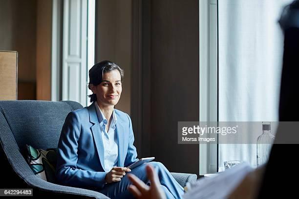 businesswoman with digital tablet in hotel meeting - businesswear fotografías e imágenes de stock