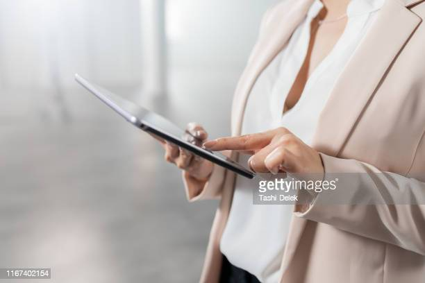 businesswoman with digital tablet in new office - real estate developer stock pictures, royalty-free photos & images