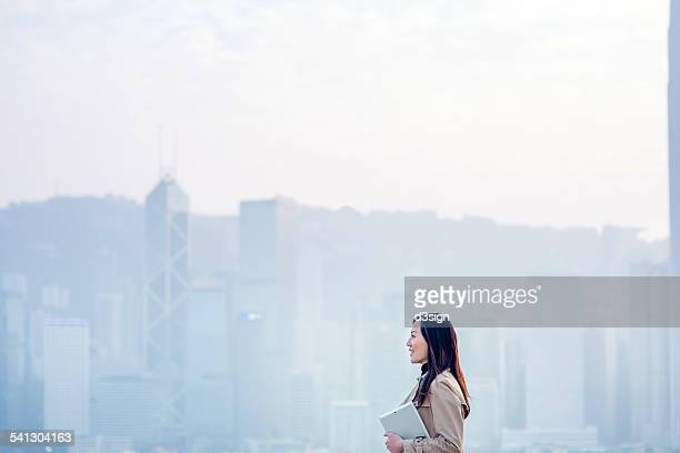 Businesswoman with digital tablet in urban city