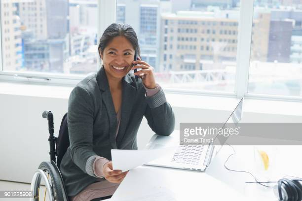 businesswoman with disability - filipino woman stock pictures, royalty-free photos & images