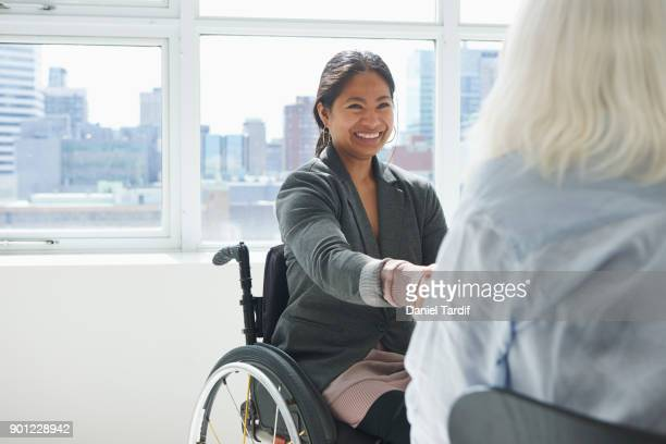 businesswoman with disability - differing abilities female business stock pictures, royalty-free photos & images