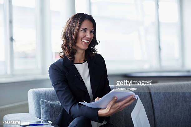 Businesswoman with documents in office