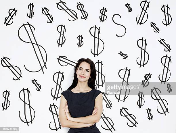 Businesswoman with dollar signs in the background