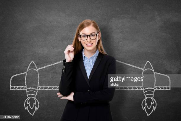 businesswoman with drawn aircraft wings - aircraft wing stock pictures, royalty-free photos & images