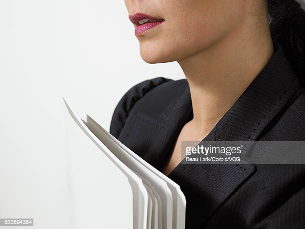 Businesswoman with file folders