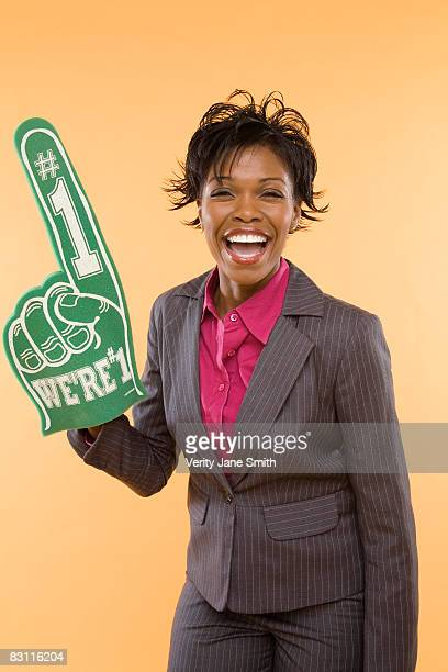 businesswoman with foam hand - foam finger stock photos and pictures