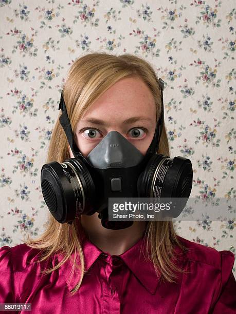 Businesswoman with gas mask on face