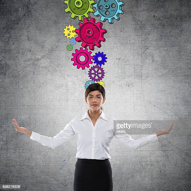 Businesswoman with gears