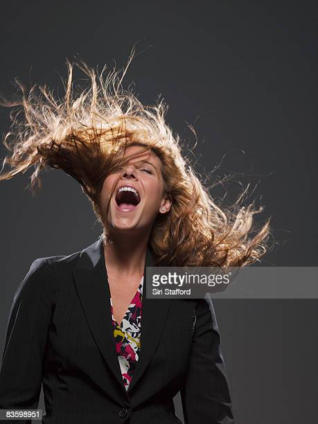 Businesswoman with hair blowing in wind