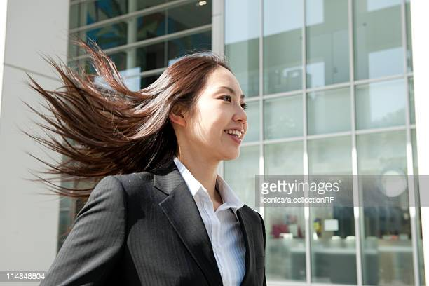 Businesswoman with hair flowing, Tokyo Prefecture, Honshu, Japan