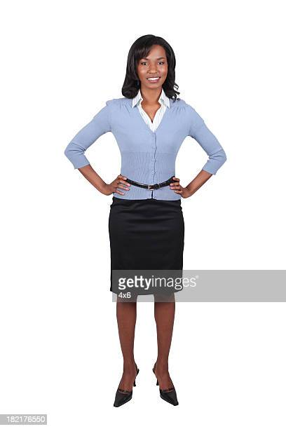 businesswoman with hands on hips - black skirt stock photos and pictures