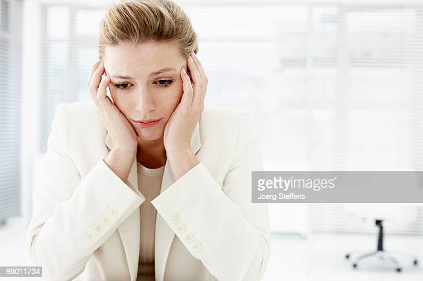 Businesswoman with head in hands