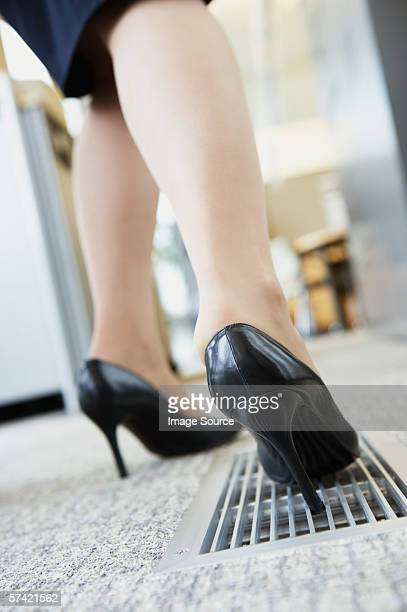 Businesswoman with heel stuck