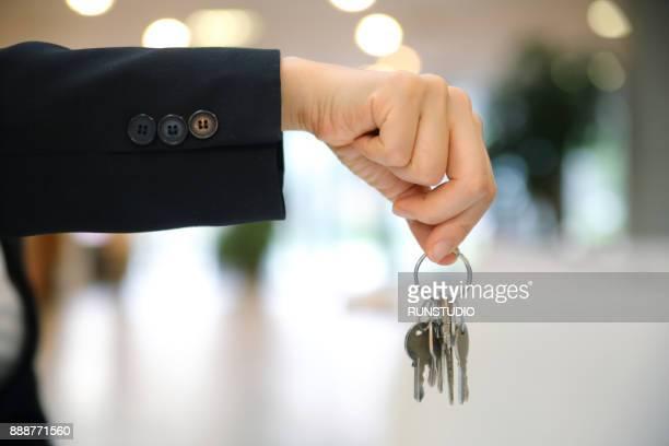 Businesswoman with keys
