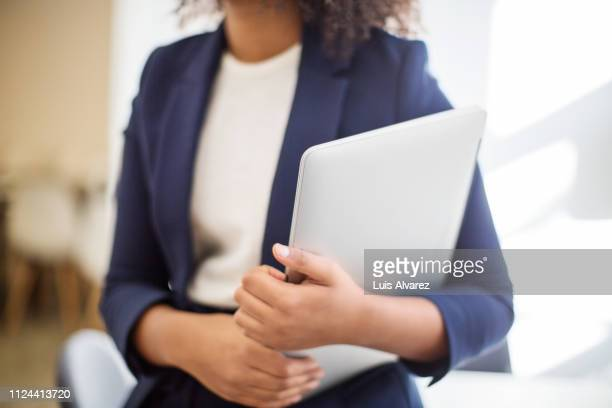 businesswoman with laptop computer in office - 四肢 ストックフォトと画像