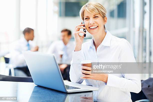 Businesswoman With Laptop On Phone Call