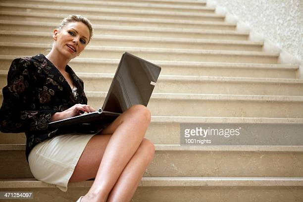 businesswoman with laptop - cross legged stock pictures, royalty-free photos & images