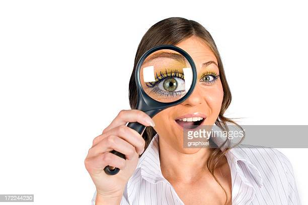 Businesswoman with magnifying glass