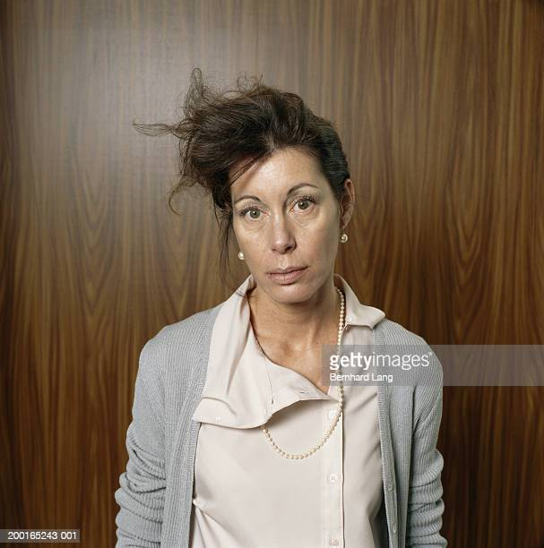 Businesswoman with messy hair and clothes, portrait