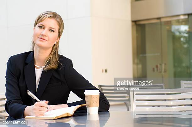 Businesswoman with notepad and pen, portrait
