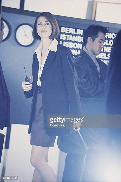 businesswoman with others in airport - category:cs1_maint:_others stock pictures, royalty-free photos & images
