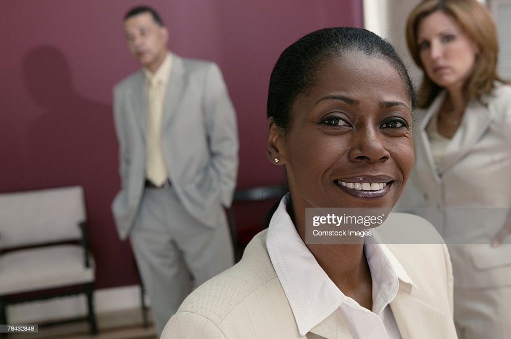 Businesswoman with others : Stockfoto