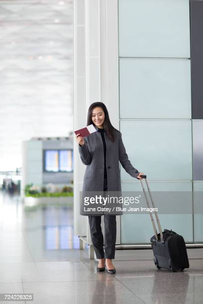 Businesswoman with passport and airplane ticket
