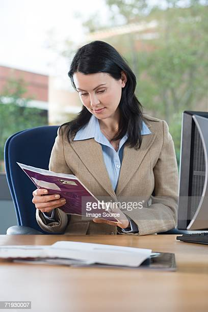 Businesswoman with post at desk