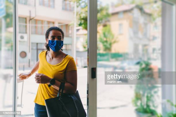 businesswoman with protective mask during covid-19 - entering stock pictures, royalty-free photos & images