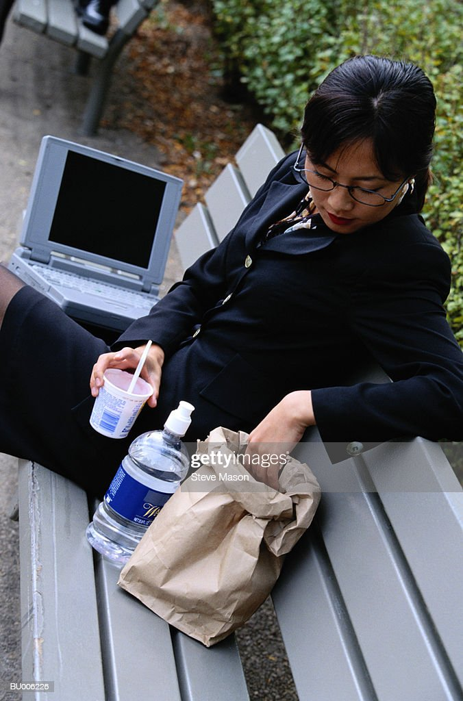 Businesswoman with Sack Lunch : Stock Photo