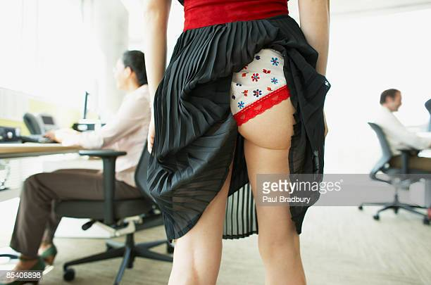 businesswoman with skirt caught in underwear - knickers photos stock pictures, royalty-free photos & images