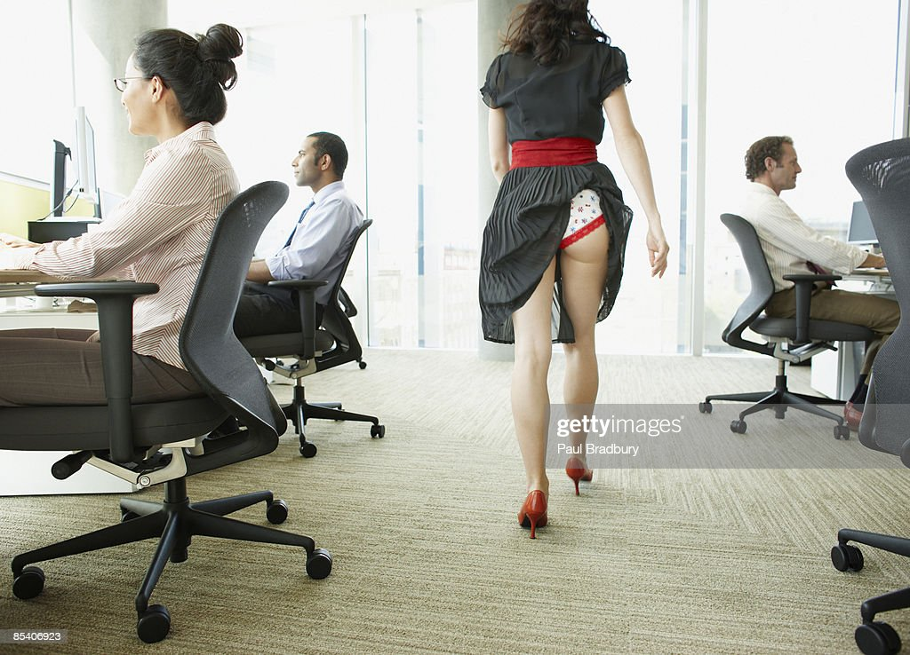 Businesswoman with skirt caught in underwear : Stock Photo