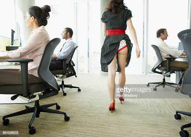 businesswoman with skirt caught in underwear - pants stock photos and pictures